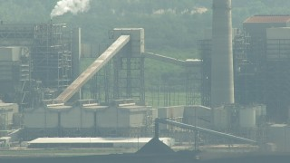 AF0001_000238 - HD stock footage aerial video pan across structures at the WA Parish Generating Station at Smithers Lake, Texas