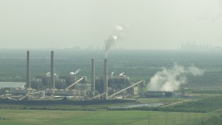 AF0001_000239 - HD stock footage aerial video zoom to a wider view of WA Parish Generating Station on Smithers Lake, Texas