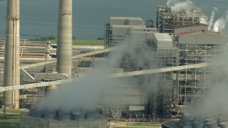 AF0001_000242 - Aerial stock footage of Panning across structures at the WA Parish Generating Station, Smithers Lake, Texas