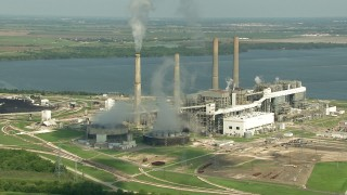 AF0001_000243 - HD stock footage aerial video zoom to a wider view of WA Parish Generating Station and smoke stacks at Smithers Lake, Texas