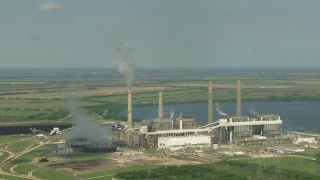 AF0001_000244 - HD stock footage aerial video of a reverse view of the lakeside power plant by Smithers Lake, Texas