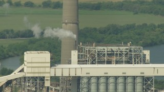 AF0001_000245 - HD stock footage aerial video of part of a smoke stack and power plant structure at Smithers Lake, Texas