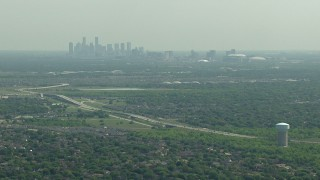 AF0001_000247 - HD stock footage aerial video approach Fort Bend Parkway with a view of the skyline of Downtown Houston, Texas