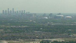 AF0001_000249 - HD stock footage aerial video of the city skyline, NRG Stadium, and the Houston Astrodome, Downtown Houston, Texas