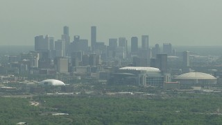 AF0001_000251 - HD stock footage aerial video of the city skyline, NRG Stadium, reveal Houston Astrodome in Downtown Houston, Texas