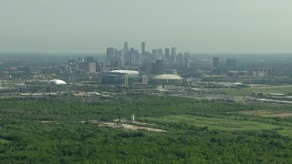 AF0001_000253 - HD stock footage aerial video approach NRG Stadium and Houston Astrodome near the Downtown Houston, Texas skyline