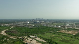 AF0001_000255 - HD stock footage aerial video fly over apartment complex to approach NRG Stadium and Houston Astrodome, Downtown Houston, Texas