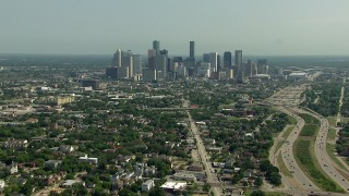 AF0001_000258 - Aerial stock footage of Following Almeda Road to approach the city skyline in Downtown Houston, Texas