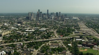 AF0001_000259 - HD stock footage aerial video of approaching the city skyline from the freeway interchange, Downtown Houston, Texas