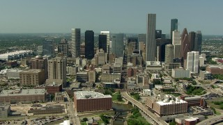 AF0001_000263 - HD stock footage aerial video orbit Harris County Jail Facility, Bakers Street Jail and city skyscrapers in Downtown Houston, Texas
