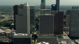 AF0001_000265 - HD stock footage aerial video orbit 1600 Smith Street and nearby skyscrapers in Downtown Houston, Texas
