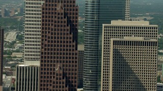 AF0001_000270 - HD stock footage aerial video tilt from Bank of America Center to reveal a parking garage in Downtown Houston, Texas