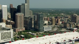 AF0001_000274 - Aerial stock footage of Flyby skyscrapers to reveal the convention center, Minute Maid Park, and the 59 freeway, Downtown Houston, Texas