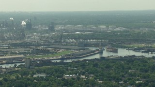 AF0001_000275 - HD stock footage aerial video flyby warehouses by the Buffalo Bayou, the 610 bridge, and an oil refinery in Harrisburg, Manchester, Texas