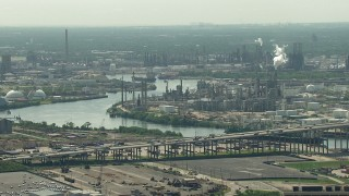 AF0001_000277 - HD stock footage aerial video of 610 Bridge spanning Buffalo Bayou near an oil refinery in Harrisburg, Manchester, Texas