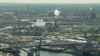 AF0001_000278 - HD stock footage aerial video of a view of an oil refinery seen while passing the 610 Bridge in Harrisburg, Manchester, Texas