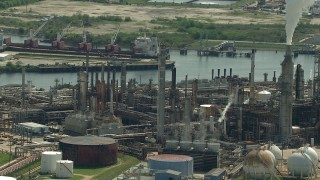 AF0001_000280 - Aerial stock footage of Pan across a riverfront oil refinery in Harrisburg, Manchester, Texas