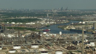 AF0001_000283 - HD stock footage aerial video oil refineries around Buffalo Bayou in Harrisburg, Manchester, Texas, Downtown Houston skyline in background