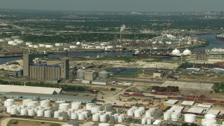 AF0001_000284 - HD stock footage aerial video of flyby an oil tanker and refineries around Buffalo Bayou in Harrisburg, Manchester, Texas