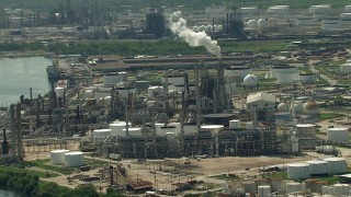 AF0001_000287 - HD stock footage aerial video approach an oil refinery by the river in Galena Park, Texas