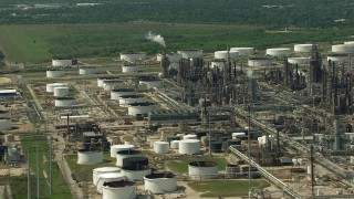 AF0001_000289 - Aerial stock footage of Flying by an oil refinery and storage tanks in Galena Park, Texas