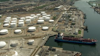 AF0001_000291 - HD stock footage aerial video fly over oil tanker and storage tanks to view the Buffalo Bayou, Pasadena, Texas