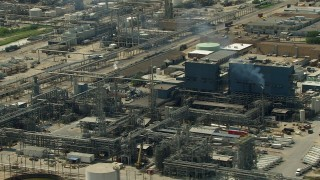 AF0001_000293 - HD stock footage aerial video oil refinery buildings and structures in Pasadena, Texas