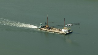 AF0001_000294 - HD stock footage aerial video track a barge sailing Buffalo Bayou, Pasadena, Texas