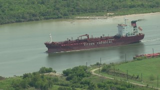 AF0001_000295 - HD stock footage aerial video track an oil tanker sailing Buffalo Bayou in Pasadena, Texas