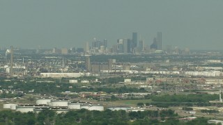 AF0001_000296 - HD stock footage aerial video of the city skyline seen from oil refineries in Pasadena, Downtown Houston, Texas