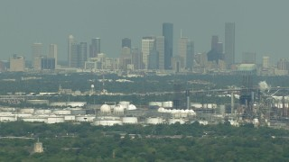 AF0001_000297 - HD stock footage aerial video of Downtown Houston skyline seen from oil refineries in Harrisburg, Manchester, Texas