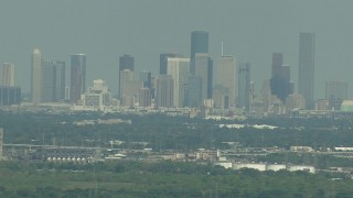 AF0001_000298 - HD stock footage aerial video of a view of the distant skyline of Downtown Houston, Texas