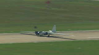 AF0001_000299 - Aerial stock footage of Tracking a military jet readying for takeoff, Ellington Airport, Houston, Texas