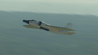 AF0001_000300 - Aerial stock footage of Tracking a military jet lifting off from Ellington Airport, Houston, Texas