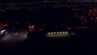 AF0001_000302 - HD stock footage aerial video flyby airplane hangars at night at Ellington Airport, Houston, Texas