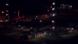 AF0001_000304 - HD stock footage aerial video of passing buildings at the Alcoa Aluminum Plant at night in Point Comfort, Texas