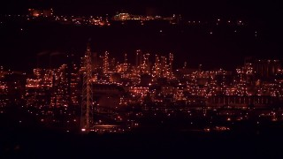 AF0001_000309 - HD stock footage aerial video of the buildings at the Alcoa Aluminum Plant, lit up for the night in Point Comfort, Texas
