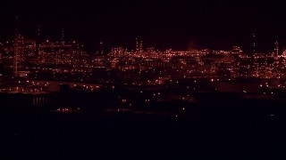 AF0001_000310 - Aerial stock footage of Passing by the Alcoa Aluminum Plant at nighttime, Point Comfort, Texas