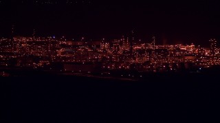 AF0001_000311 - HD stock footage aerial video of the Alcoa Aluminum Plant with lights at nighttime, Point Comfort, Texas