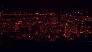 AF0001_000312 - HD stock footage aerial video of the Alcoa Aluminum Plant with buildings lit up for the night, Point Comfort, Texas
