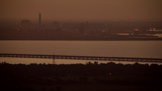AF0001_000316 - HD stock footage aerial video of Alcoa Aluminum Plant across Lavaca Bay at sunrise, Point Comfort, Texas