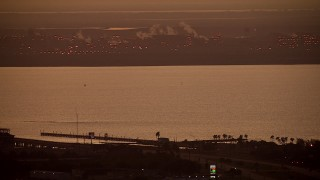 AF0001_000317 - Aerial stock footage of Pan across Lavaca Bay at sunrise and reveal Alcoa Aluminum Plant, Point Comfort, Texas