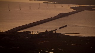 AF0001_000318 - HD stock footage aerial video of the Lavaca Bay Causeway with light traffic in Port Lavaca, Texas, sunrise