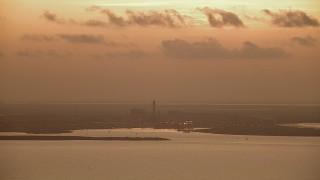 AF0001_000319 - HD stock footage aerial video of Alcoa Aluminum Plant across Lavaca Bay, Point Comfort, Texas, sunrise