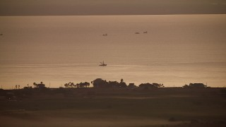 AF0001_000322 - HD stock footage aerial video of a boat in Lavaca Bay at sunrise, Texas