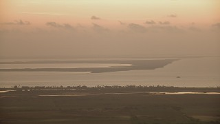 AF0001_000323 - Aerial stock footage of A view of marshland across Matagorda Bay, Texas, sunrise
