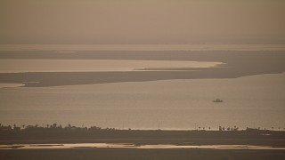 AF0001_000324 - Aerial stock footage of Flyby Matagorda Bay at sunrise, and zoom in to a closer view, Texas
