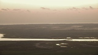 AF0001_000327 - HD stock footage aerial video of wetlands on the shore of Powderhorn Lake at sunrise, Texas