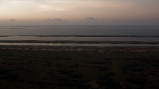 AF0001_000329 - Aerial stock footage of Flying over wetlands to approach Espiritu Santo Bay, Texas, sunrise