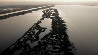 AF0001_000331 - HD stock footage aerial video flyby wetlands on the shore of Espiritu Santo Bay, Texas, sunrise